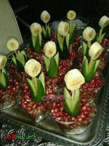تزیین میوه شب یلدا بصورت گل با انار و خیار و موز