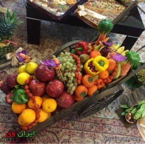 چیدن میوه ها داخل سبد برای شب یلدا