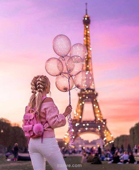 عکس پروفایل دخترونه کنار برج ایفل پاریس در شب که چراغ هاش روشنه